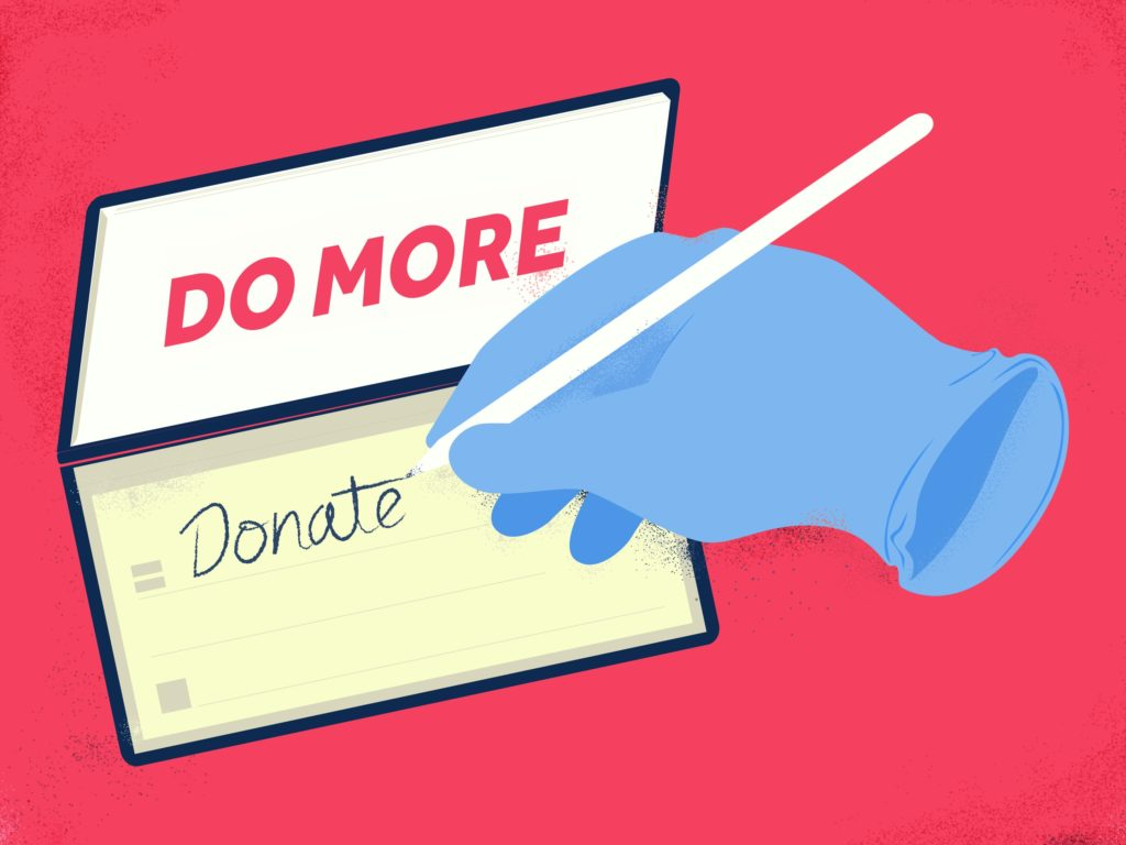 An image of someone writing a cheque, donating to charity.