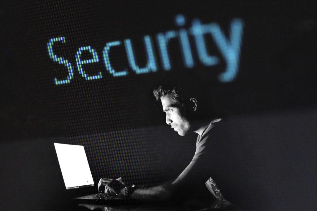 An image of a hacker at a computer. Remember to change your passwords to keep your accounts secure. This is a great way to protect your cybersecurity.