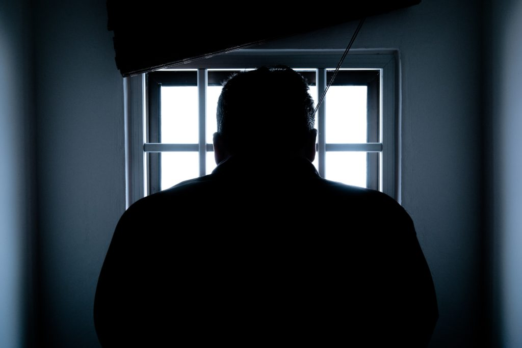 An image of a man in jail after Colombian police arrest Gozi malware suspect after 8 years at large. This is the last story of our cybersecurity roundup.