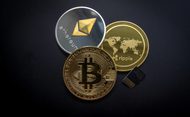A photo of bitcoin, ripple, and etherium,  three major cryptocoin companies. Another cryptocurrency robbery was committed in August, resulting in the loss of millions of dollars.