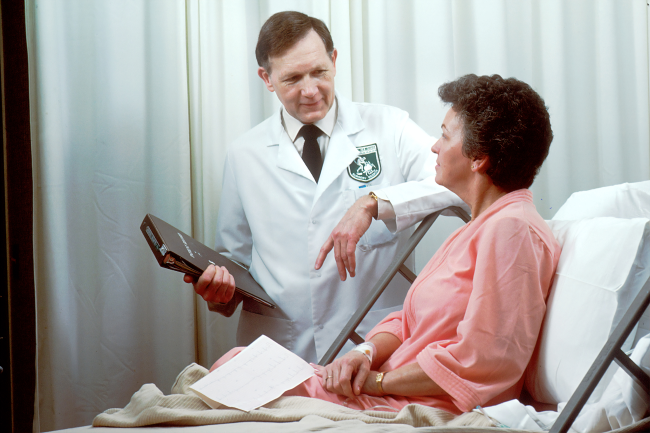 Image of a doctor speaking to a patient. Although in person interactions with a provider may be limited, most telemedicine platforms allow patients to speak with providers through virtual communication.